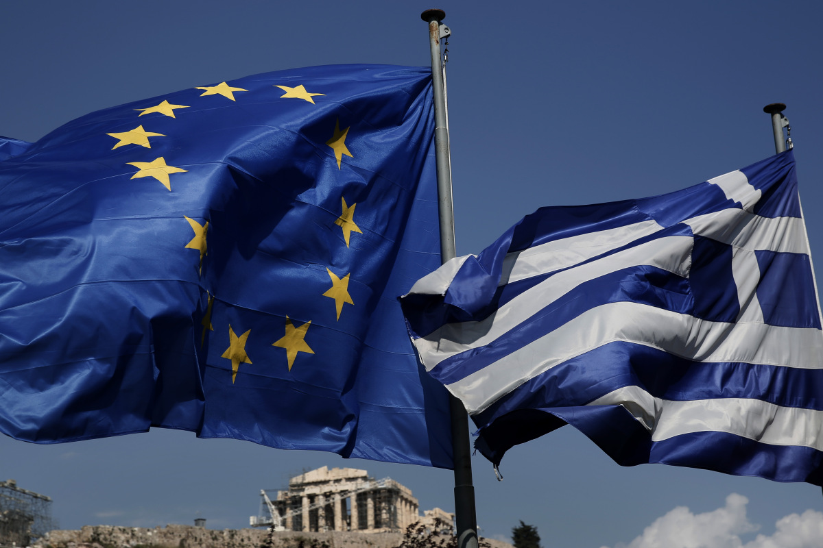 An EU and a Greek flag fly in front of the ancient Parthenon temple, in Athens, on Wednesday, April 9, 2014. Greece announced Wednesday it was returning to international bond markets for the first time in four years amid growing signs of confidence in the country at the forefront of the European debt crisis. (AP Photo/Petros Giannakouris) ORG XMIT: XPG101