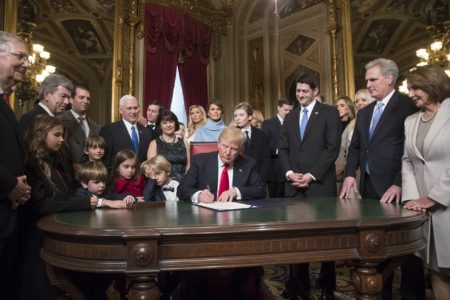 WASHINGTON, DC - JANUARY 20:  President Donald Trump is joined by the Congressional leadership and his family as he formally signs his cabinet nominations into law, in the President's Room of the Senate, at the Capitol in Washington, January 20, 2017. From left are Senate Majority Leader Mitch McConnell, R-Ky., Sen. Roy Blunt, R-Mo., Donald Trump Jr., Vice President Mike Pence, Jared Kushner, Karen Pence, Ivanka Trump, Melania Trump, Barron Trump, Speaker of the House Paul Ryan, R-Wis., Majority Leader Kevin McCarthy, D-Calif., House Minority Leader Nancy Pelosi, D-Calif.  (Photo by J. Scott Applewhite - Pool/Getty Images)