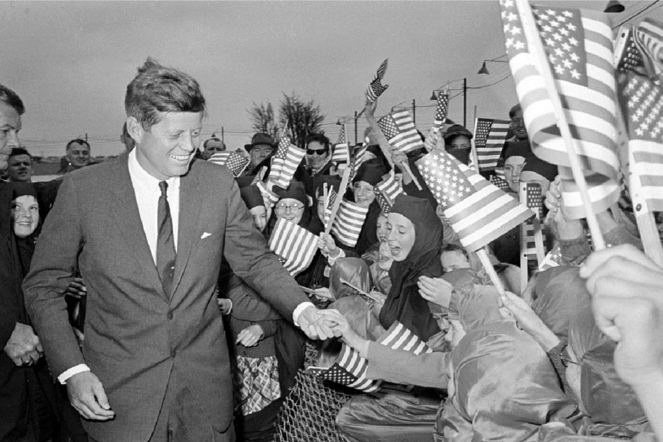 U.S. President John F. Kennedy is greeted by an enthusiastic crowd of children and nuns from the Convent of Mercy, as he arrives from Dublin by helicopter at Galway's sports ground, Ireland, June 29, 1963. (AP Photo)